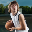 Asian teenage boy with basketball aiming — Stock Photo
