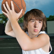Royalty-Free Stock Photo: Asian teenage boy with basketball ready to attack
