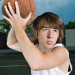 Stock Photo: Asiteenage boy with basketball ready to attack