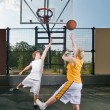 Teenagers playing streetball — Stock Photo
