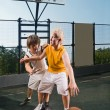 Two teenage players with basketball — Stock Photo #3527640
