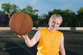 Happy teenager girl with basketball — Stock Photo