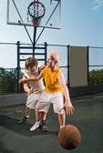 Two teenage players with basketball — Stock Photo