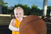 Smiling teenage girl with basketball — Stock Photo