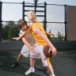 Stock Photo: Teenagers playing basketball