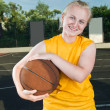 Stock Photo: Teenage girl with basketball