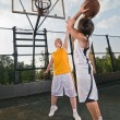 Teenagers playing basketball — Stock Photo #3539155