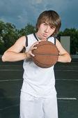 Teenage basketball player — Stock Photo