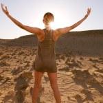 Greeting the sun in desert — Stock Photo #3664285