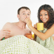 Young couple surprised in bed — Stock Photo