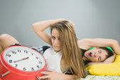 Young couple with alarm clock — Stock Photo