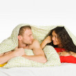 Couple Hiding Under Covers in Bed — Stock Photo #3760912