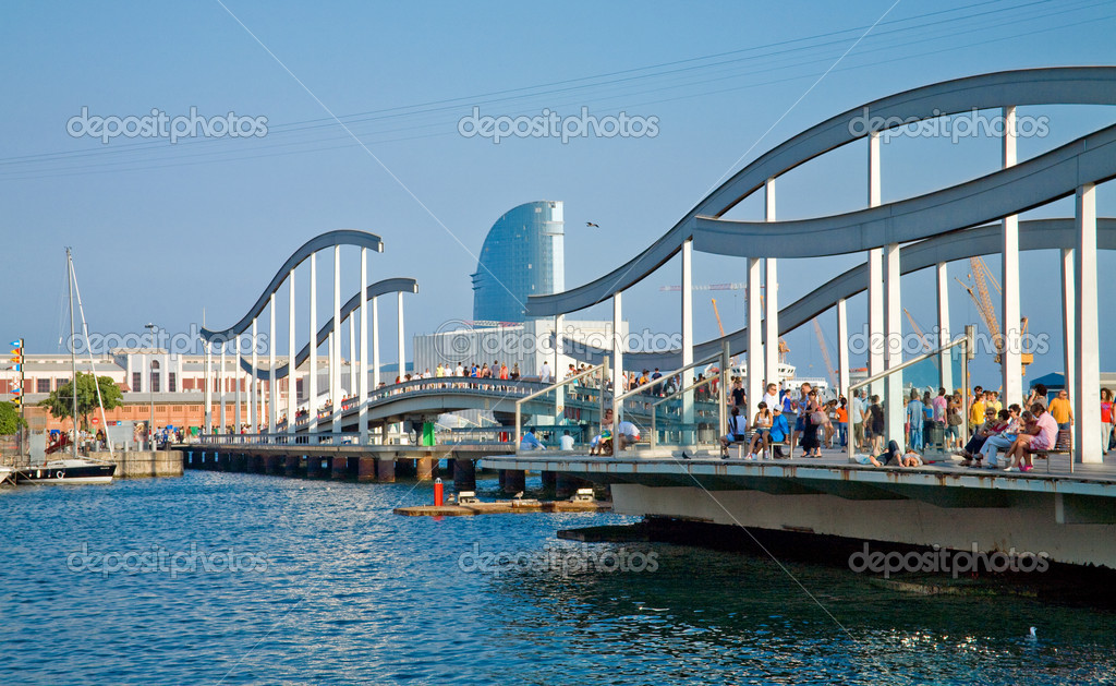 Tourists on the &quot;Rambla del Mar&quot; boardwalk in Barcelona, Spain. Approximately one and half million visit this city per year.  Stock Photo #3393020