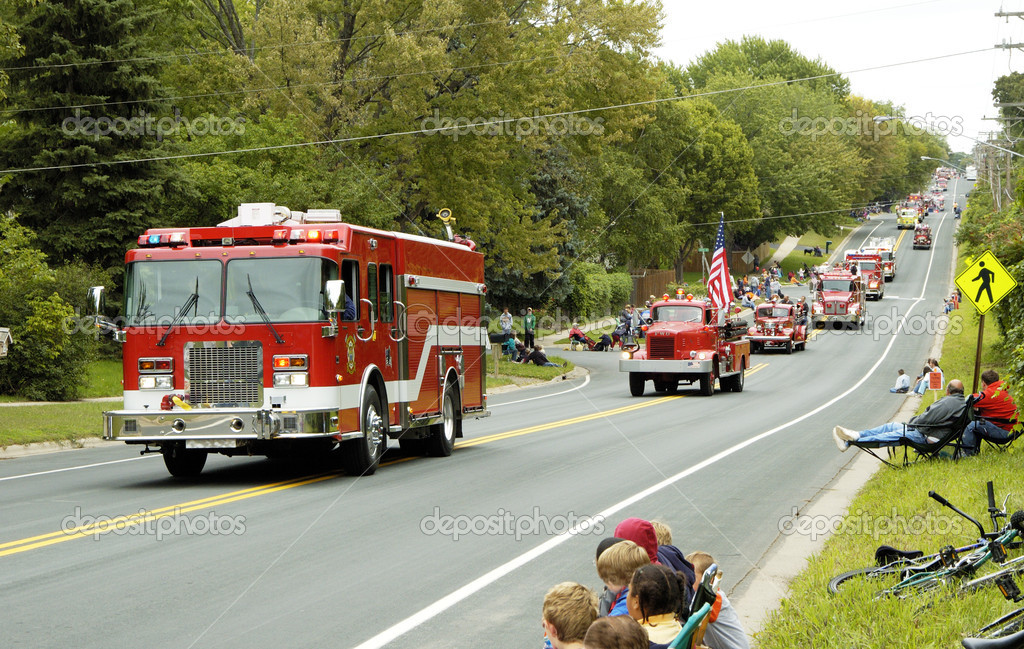 Fire and rescue vehicles being driven in a fire muster parade.  Stock Photo #2943654