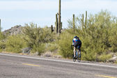 Biking in the desert — Stock Photo