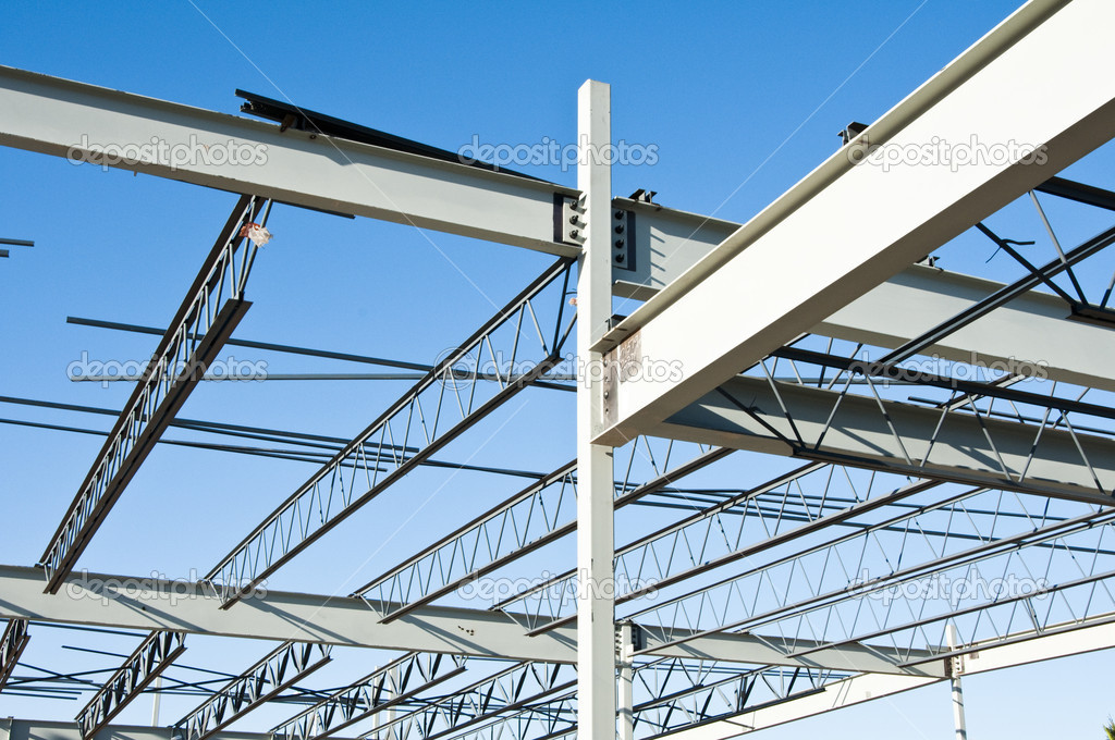The structural steel structure of a new commercial building against a clear blue sky in the background — Stock Photo #3196132