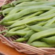 Runner beans on basket - Stock Photo