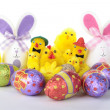 Royalty-Free Stock Photo: Easter bunnies and chicks with eggs over white