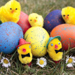 Stock Photo: Colored easter eggs on grass lawn