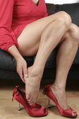Woman legs massaging aching feet — Stock Photo
