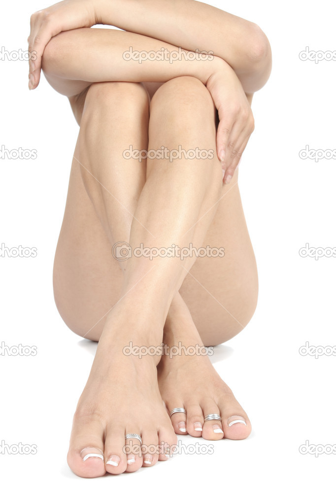 Woman legs and feet isolated over white background  Stock Photo #2861356