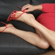 Woman legs with short red dress — Stock Photo #3087312