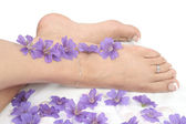 Womans feet over white — Stock Photo