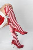 Santa helper woman with dress and heels stockings — Stock Photo