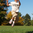 Young boy jumping in the air — Stock Photo