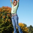 Teenage girl jumping in the air — Stock Photo