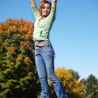 Teenage girl jumping in the air — Stock Photo #2717622