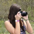 Teen girl with a camera — Foto de Stock
