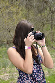 Teen girl with a camera — Stock Photo