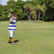 Young boy golfing — Stock Photo