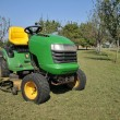 Stock Photo: Green lawn mower