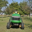 Green lawn mower — Stock Photo