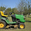 Tractor mowing grass — Stockfoto
