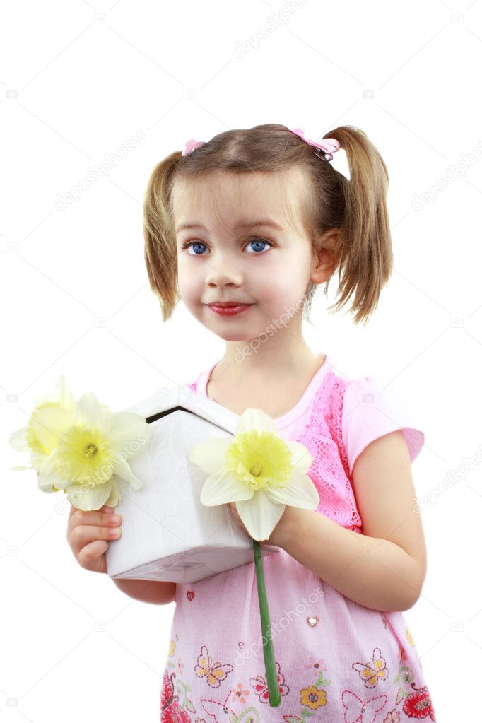 Adorable little girl  holds fresh picked flowers and a giftbox for Mom on Mother's Day.  Stock Photo #2839842