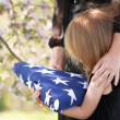 Stock Photo: Child Holding Parent's Flag