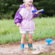 Stock Photo: Child Playing in the Mud