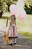 Child with Teddy Bear and Balloons — Stock Photo
