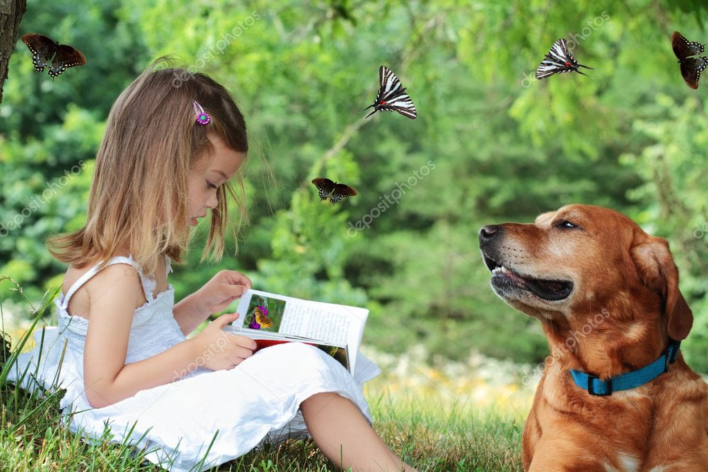 Little girl sits under a tree reading a book while her faithful dog sits nearby watching butterflies fly around them. — Foto Stock #3307415