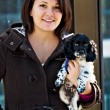 Beautiful woman with a puppy — Stock Photo