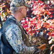 Stock Photo: Turkey hunter with box call