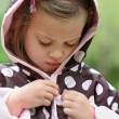 Child Putting on Raincoat — Stock Photo