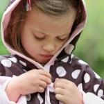 Child Putting on Raincoat — Stock Photo