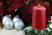 Christmas Candle and Poinsettias — Stock Photo