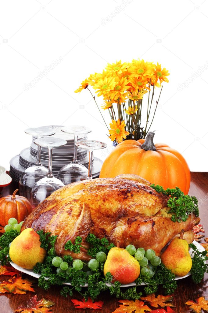 Thanksgiving turkey dinner with fresh fruit, dishes and flowers. — Stock Photo #3777995