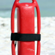 Red buoy on beach — Stock Photo
