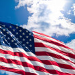 American Flag and Cloudscape - Stock Photo